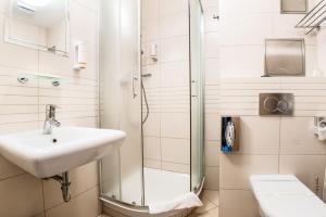 Kúpeľňa v ubytovaní Alexandra Hotel
