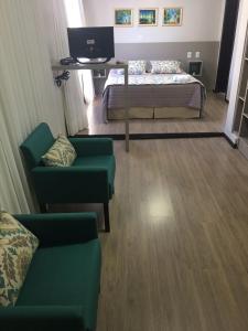 Uma área de estar em Hotel Zata e Flats