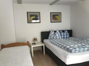 Ein Bett oder Betten in einem Zimmer der Unterkunft Ferienwohnung Rosenstrasse