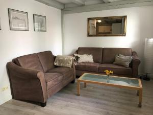 Ein Sitzbereich in der Unterkunft Ferienwohnung Rosenstrasse