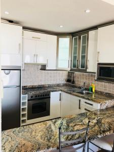 A kitchen or kitchenette at Regency Torviscas Apartments and Suites