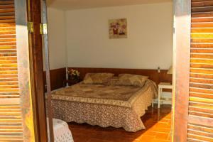 Cama ou camas em um quarto em Villa Donn'Anna