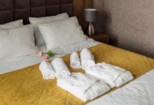 Кровать или кровати в номере Florinn Hotel
