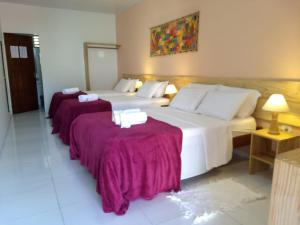 A bed or beds in a room at Pousada Maresia