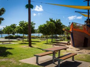 A garden outside Palm Beach Holiday Resort, Unit 35