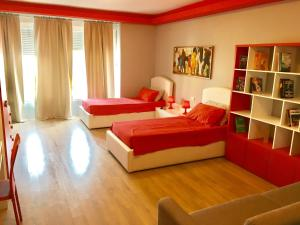 A bed or beds in a room at B&B Tirana Smile