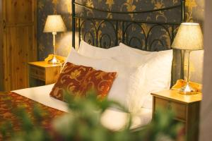 A bed or beds in a room at Abella Suites & Apartments by Artery Hotels
