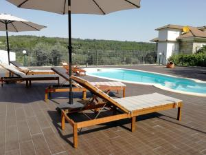 The swimming pool at or near Quinta do Malhô-Turismo Rural