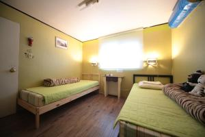 A bed or beds in a room at Comeinn Guesthouse Hongdae - Female Only