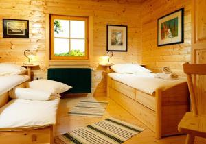 Postelja oz. postelje v sobi nastanitve Farm Stay Pirc
