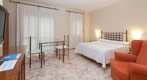 Cama o camas de una habitación en Apartamentos Vértice Bib Rambla
