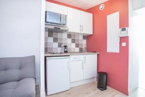 Cuisine ou kitchenette dans l'établissement Appartement 8 - tout équipé - Carmes, Toulouse