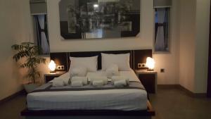 Un ou plusieurs lits dans un hébergement de l'établissement Villa Rumah Putih Abu Abu