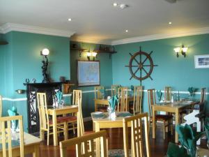 Ein Restaurant oder anderes Speiselokal in der Unterkunft The Old Pier Guest Accommodation