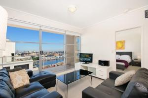 A seating area at Astra Apartments Sydney