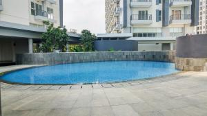 The swimming pool at or near Luxurious Studio Apartment at Casa De Parco By Travelio