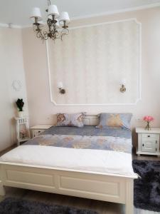A bed or beds in a room at Adagio Residence