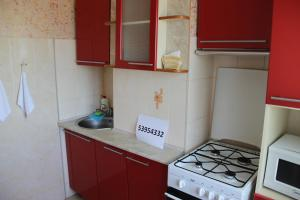 A kitchen or kitchenette at Apartment on Lukyanenko 95 korp 2