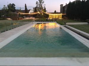 The swimming pool at or near Hospes Palacio de San Esteban