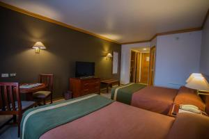 Cama o camas de una habitación en Hotel Diego de Almagro Puerto Montt