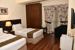 A bed or beds in a room at Royalton Hotel Rawalpindi