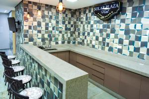 A kitchen or kitchenette at Solar Plaza Hotel