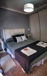 Una cama o camas en una habitación de Departamento Centro