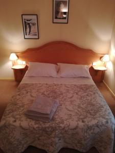 Un ou plusieurs lits dans un hébergement de l'établissement hotel de la place