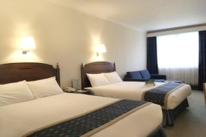 A bed or beds in a room at Holiday Inn Cambridge, an IHG Hotel