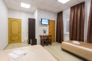A bed or beds in a room at Dynasty Lefortovo Park-Hotel