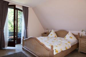 Ein Bett oder Betten in einem Zimmer der Unterkunft Wennhof