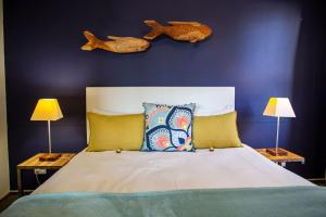 A bed or beds in a room at Desert Sands Boutique B&B | Self-Catering