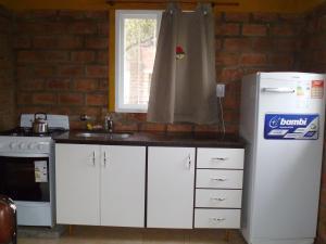 Una cocina o kitchenette en Cabañas Capilla del Monte
