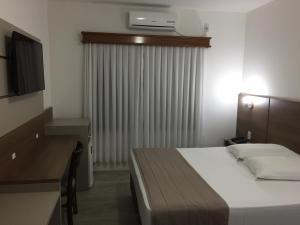 Cama ou camas em um quarto em Hotel Romer