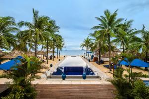 The swimming pool at or near Sunrise Premium Resort & Spa Hoi An