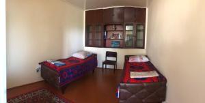 Cama ou camas em um quarto em Shaki Host House