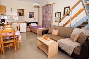 Χώρος καθιστικού στο Palmira Apartments