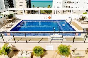 Uma vista da piscina em Kastel Manibu Recife - Boa Viagem ou nos arredores