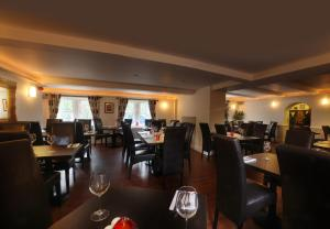 A restaurant or other place to eat at The Old Bell Inn