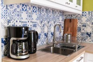 Küche/Küchenzeile in der Unterkunft Masaryk Apartments Prague