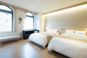 A bed or beds in a room at Fujisawa Hotel En