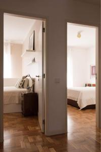 A bed or beds in a room at Casa da Colina - Braga Guesthouse