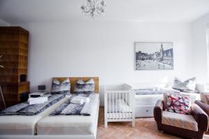 Ein Bett oder Betten in einem Zimmer der Unterkunft Auwald Apartment