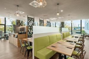 A restaurant or other place to eat at Super 8 by Wyndham Munich City North