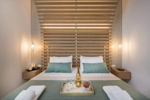 A bed or beds in a room at Agave Suites