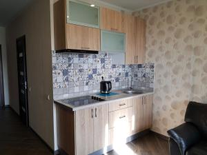 A kitchen or kitchenette at Loft na jubilee 40-1