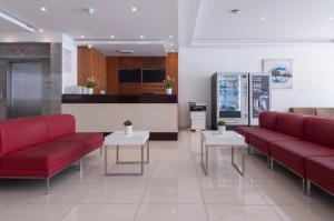 A seating area at Blubay Apartments by ST Hotels