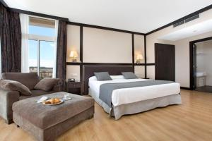 A bed or beds in a room at Gran Hotel Monterrey & Spa