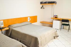 A bed or beds in a room at Vale Verde Palace Hotel