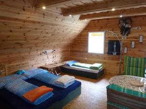 Posteľ alebo postele v izbe v ubytovaní Vesnická usedlost